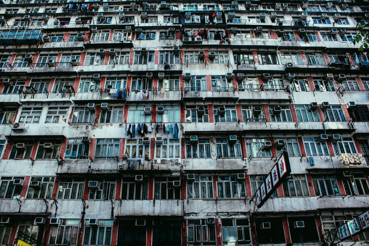 Architecture of Hong Kong. The Architect - 2018 EyeEm Awards Air Conditioner Apartment Architecture Backgrounds Balcony Building Building Exterior Built Structure City Day Full Frame Housing Development In A Row Low Angle View Nature No People Outdoors Repetition Residential District Window