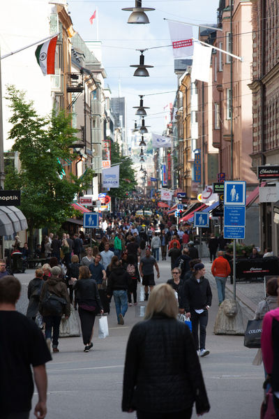 Downtown Stockholm pedestrian shopping area Shopping Architecture Building Exterior Built Structure City Crowd Day Downtown District Flag Land Vehicle Large Group Of People Lifestyles Masses Men Outdoors Pedestrian Zone People People And Places Real People Road Street Walking Women