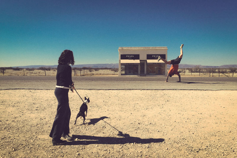 When two Romanians in Texas (Dallas and Houston) and a dog decided to take a 1,500 mile road trip to Marfa, West Texas, things became magical. Clear Sky Day Dog Domestic Animals Friendship Full Length Leisure Activity Mammal Marfa Texas Men One Animal One Person Outdoors People Pets Prada Marfa Real People Road Trip Shadow Sky Sunlight Travel West Texas Miles Away