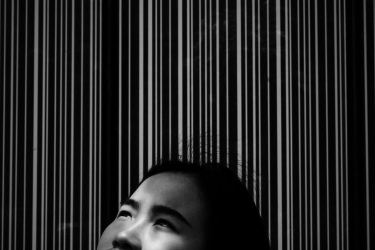 Cropped image of woman against patterned wall