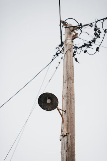 Cable Clear Sky Connection Day Electricity  Focus On Foreground Hanging Lighting Equipment Low Angle View Metal Nature No People Outdoors Pole Power Line  Power Supply Sky Technology Telephone Line Wire Wood - Material Wooden Post
