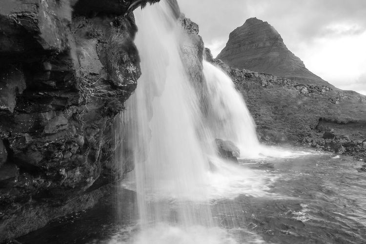 Kirkjufell Motion Water Long Exposure Waterfall Scenics Beauty In Nature Flowing Rock - Object Nature Flowing Water Iceland Travel Destinations Power In Nature Outdoors Waterfront Splashing Non-urban Scene Day Purity Tranquility Sky
