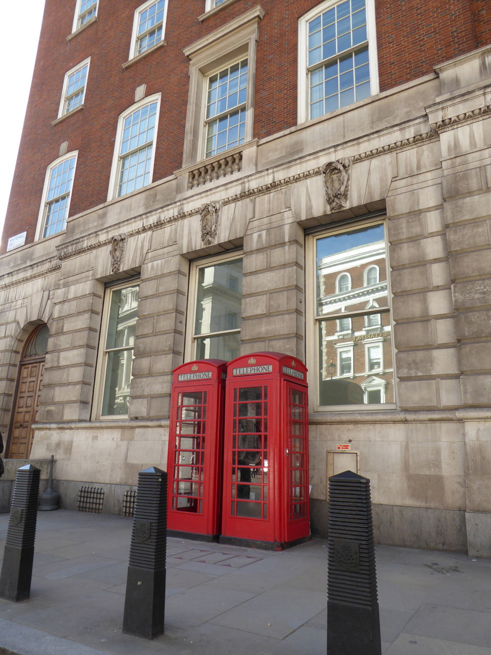 architecture, building exterior, built structure, red, communication, telephone booth, day, outdoors, pay phone, no people, technology