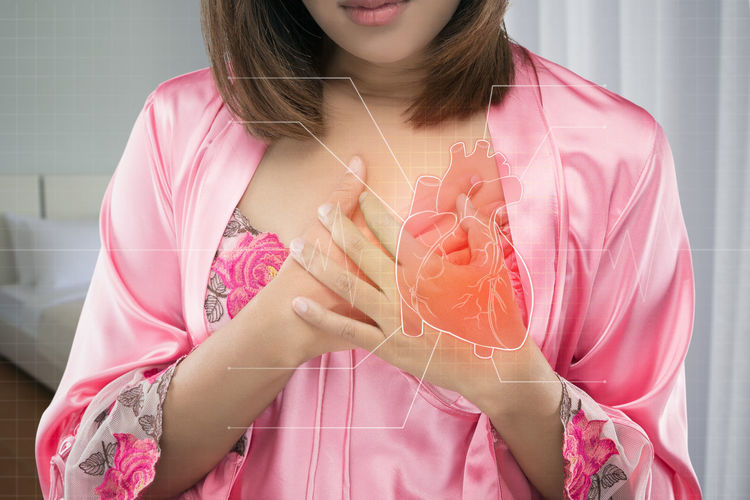 Digital composite image of woman suffering from heart pain