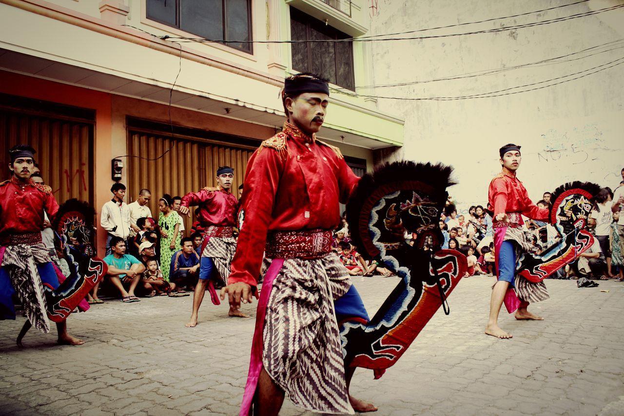 Kuda Lumping Dancer Performing Traditional Dance While People Watching