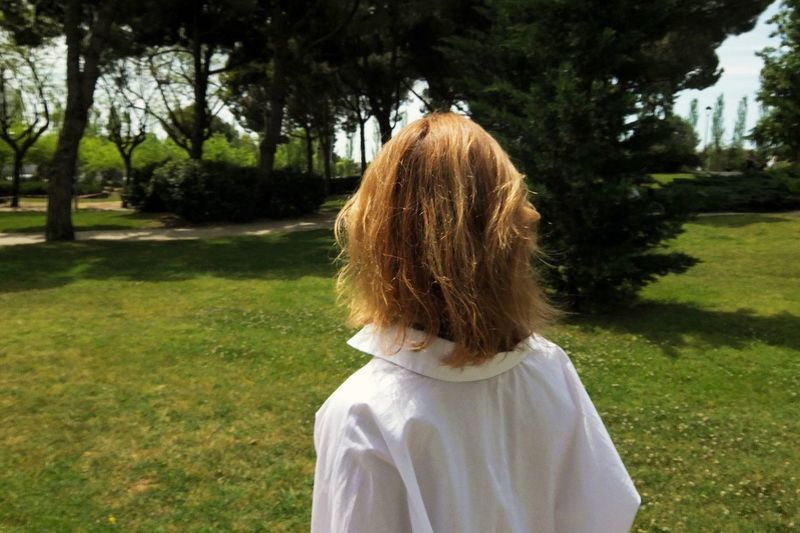 Rear View Girl Standing In Garden