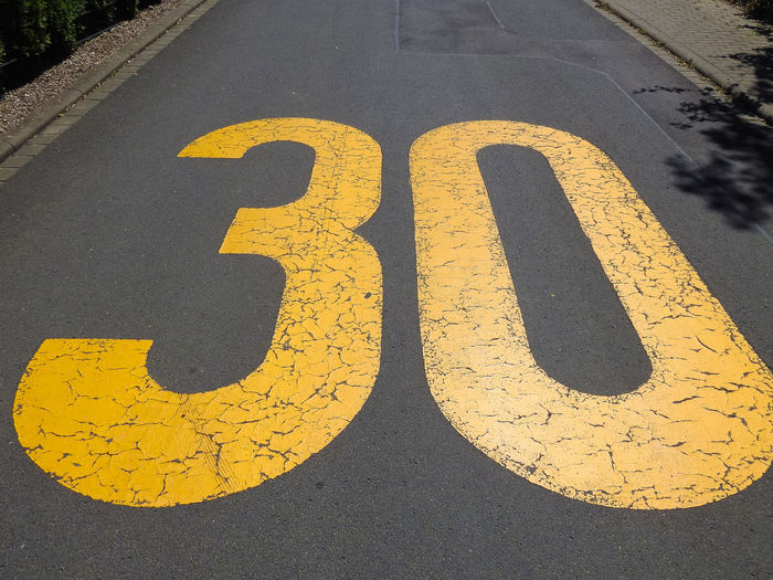 High angle view of numbers on road