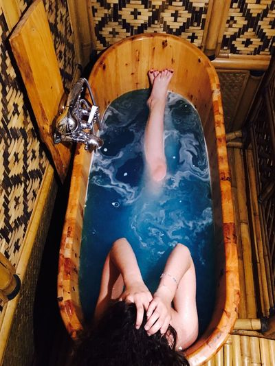High Angle View Of Woman Soaking In Bathtub