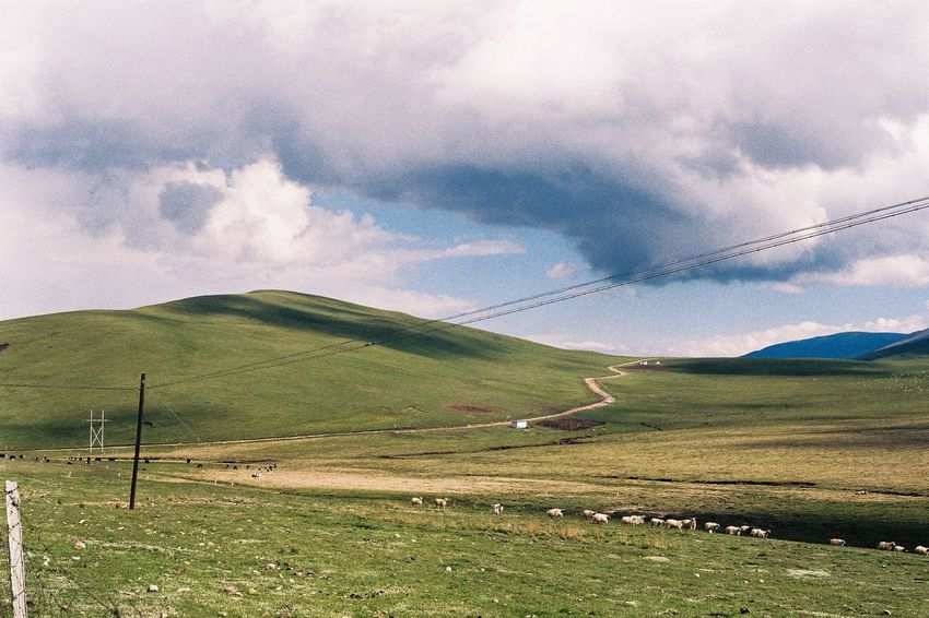 Film Photography Landscape Nature Scenics Cloud - Sky Sky Mountain Beauty In Nature Tranquility Grass Outdoors No People Tranquil Scene Day Green Color Rural Scene