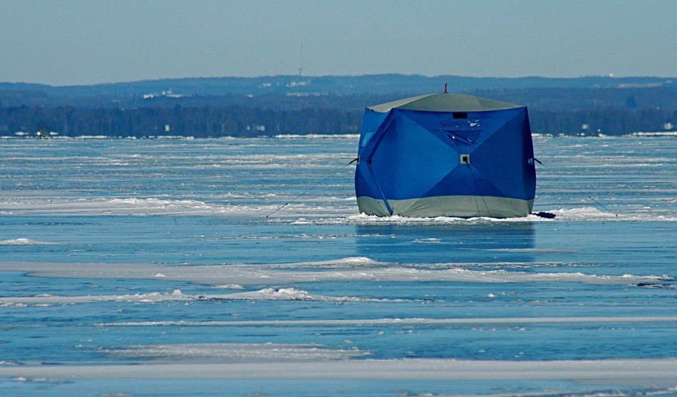 New modern ice fishing hut or tent Blue Ice Fishing Tent Clear Frozen Lake Cold Cold Temperature Frozen Lake, New Fishing Hut Or Tent Recreational Pursuit Winter Ice Fishing Lake Simcoe Light Relections On Ice