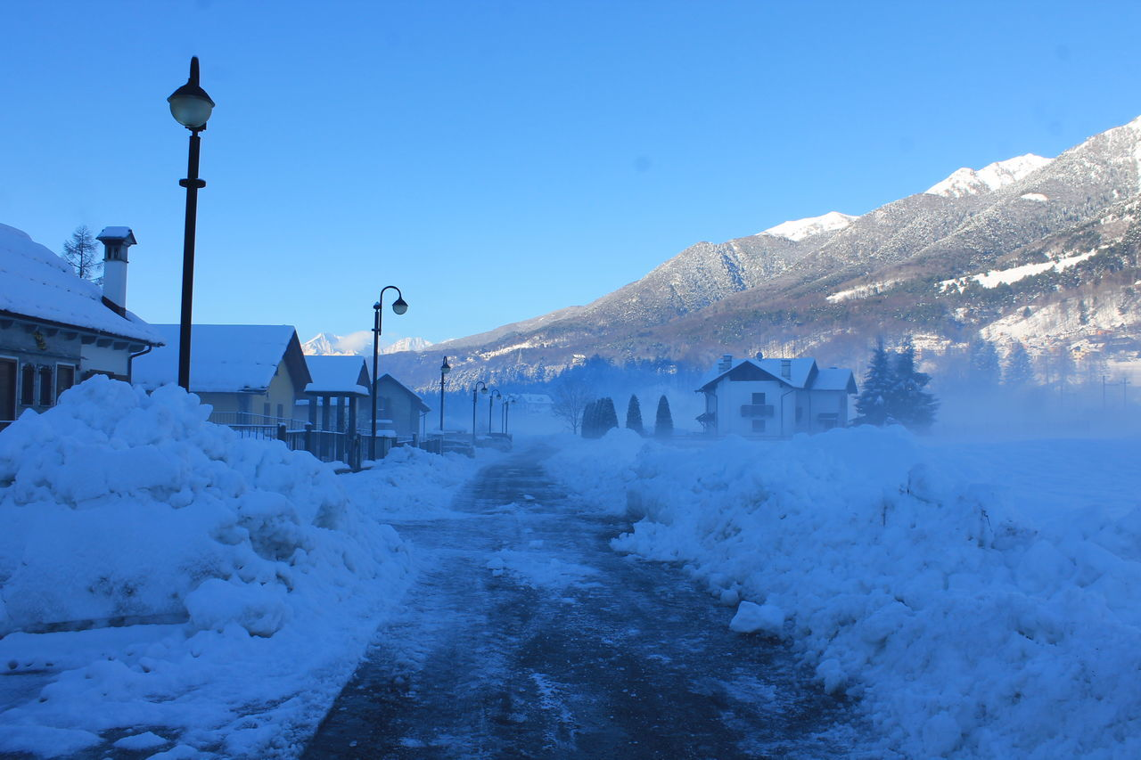 winter, snow, cold temperature, mountain, weather, nature, frozen, built structure, white color, architecture, outdoors, day, clear sky, scenics, building exterior, no people, beauty in nature, blue, mountain range, snowdrift, sky