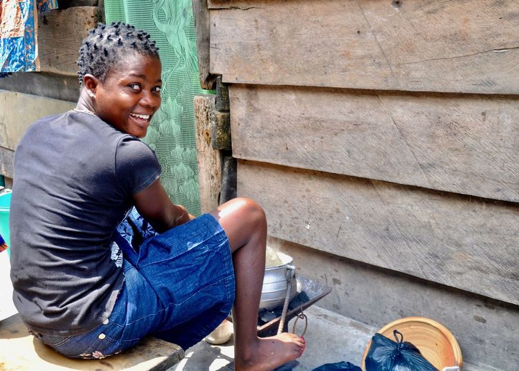 African Faces of Africa Ghana Woman africa african beauty barefoot African Faces Of Africa Ghana Woman Africa African Beauty Casual Clothing Emotion Fufu Happiness Hut Looking At Camera One Person Portrait Poverty Preparing Food Sitting Slum Smiling Social Issue Social Issues Young Adult