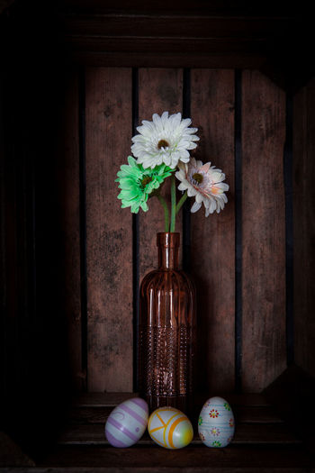 Gerbera flowers in a vase in a vintage looking wooden crate Celebration Container Decoration Easter Egg Flower Flower Arrangement Flower Head Flowering Plant Food Food And Drink Freshness Holiday Indoors  Multi Colored Nature No People Plant Still Life Table Vase Wood - Material