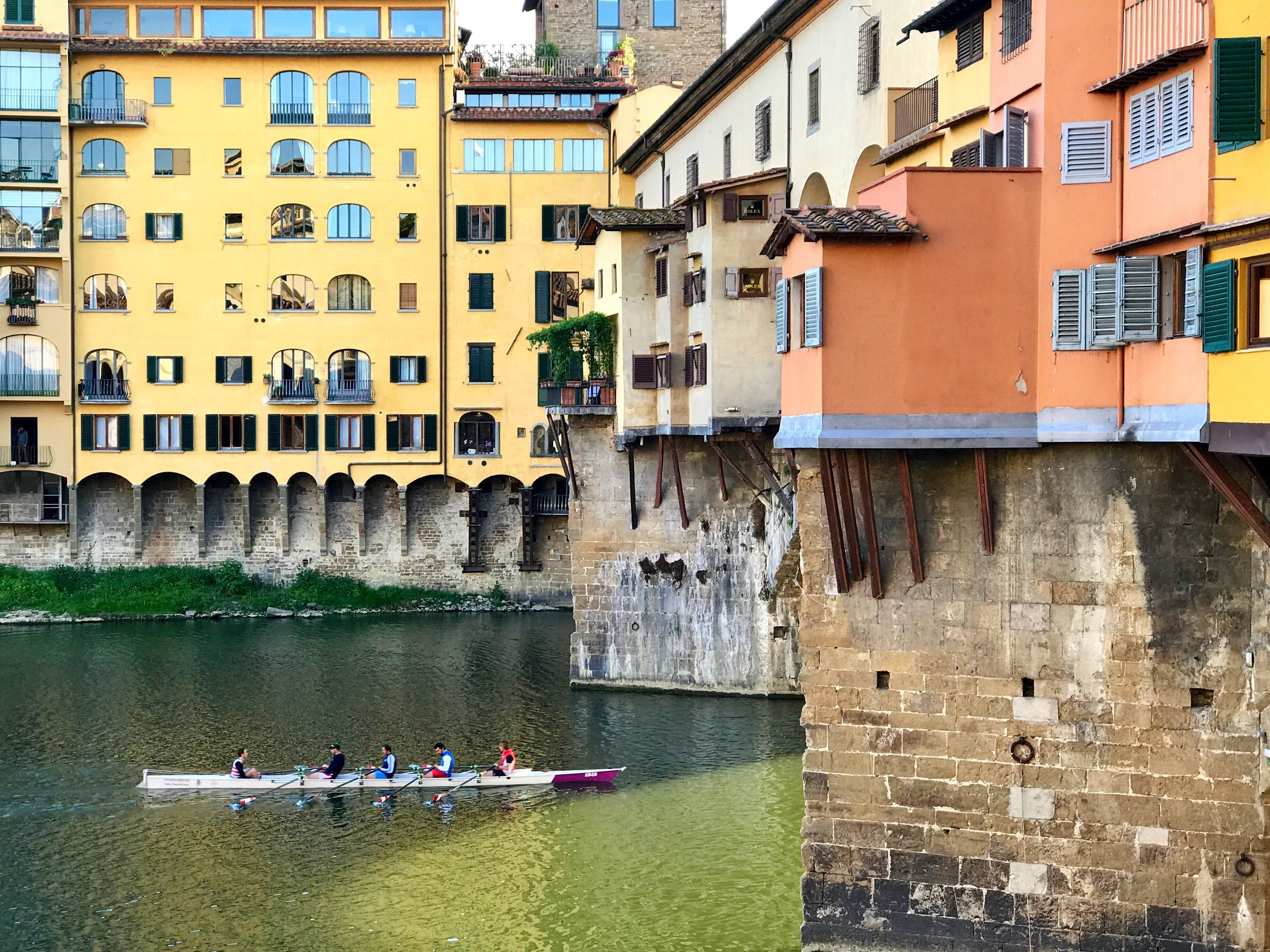 architecture, building exterior, built structure, water, real people, outdoors, day, window, men, waterfront, transportation, large group of people, leisure activity, rowing, oar, nautical vessel, nature, city, people