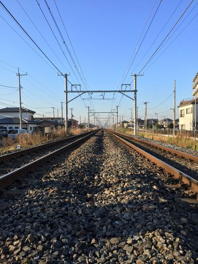 Surface Level Of Railway Tracks Against Clear Blue Sky