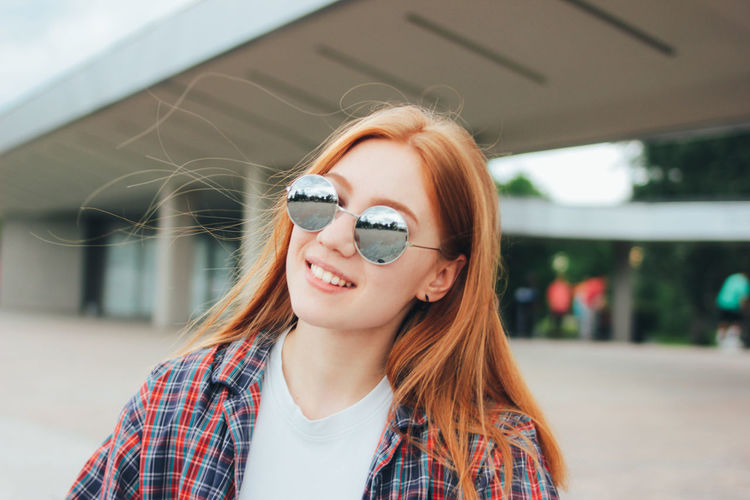 Close-up of female student wearing sunglasses