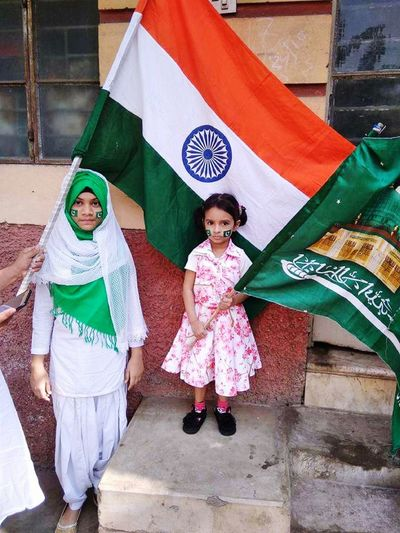 Portrait of girls standing with flags
