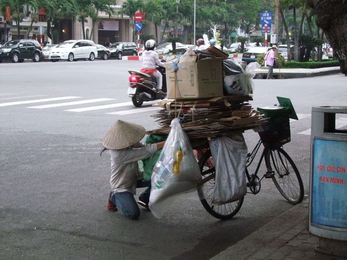 Recycling! Composition Ho Chi Minh City Making A Living Shaded Bicycle Capital City City Life City Street Coolie Hat Environmental Issues Full Frame Kneeling Down Mode Of Transport No Incidental People One Person Outdoor Photography Real People Recyling Responsibility Road Rubbish Collection Tour Destination Transportation Travel Destination Waste Management