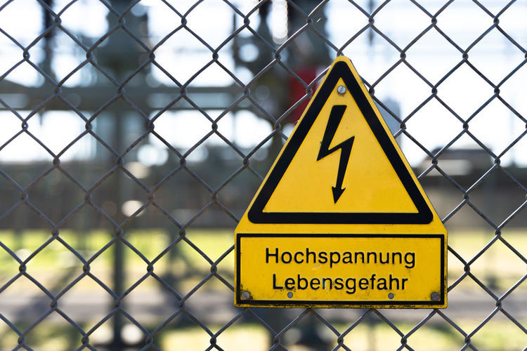 Warning sign on chainlink fence