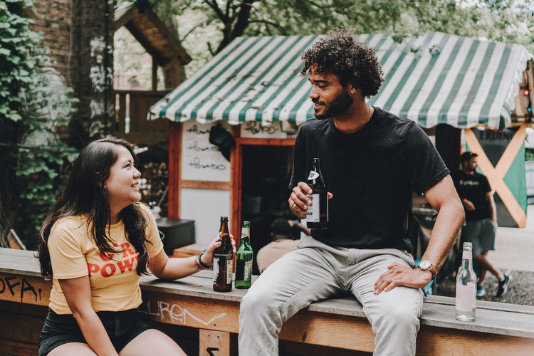 #FREIHEITBERLIN Drinking Focus On Foreground Food And Drink Leisure Activity Lifestyles Real People Sitting Togetherness Two People Young Adult Young Men Young Women Youth Culture