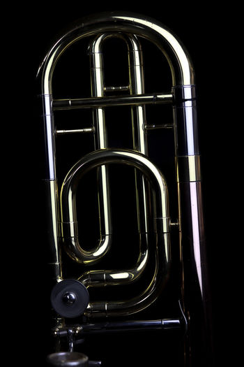 Music Instrument Trombone Metal Studio Shot Brass Instrument  Musical Instrument Indoors  Black Background No People Music Close-up Brass Arts Culture And Entertainment Wind Instrument Single Object Shiny Cut Out Reflection Simplicity Technology Curve Connection Steel Silver Colored