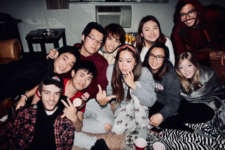 Adult Cheerful Day Eyeglasses  Friendship Front View Happiness Indoors  Lifestyles Looking At Camera Medium Group Of People People Portrait Real People Sitting Smiling Standing Teenage Girls Togetherness Young Adult Young Men Young Women
