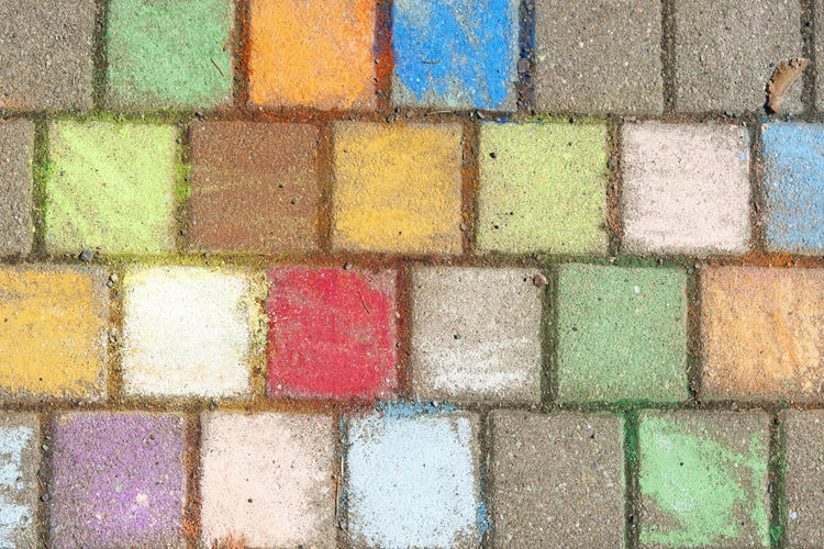 Chalk at the pavement. Backgrounds Chalk Chalk Art Close-up Colorful Full Frame Kid Multi Colored Outdoors Pattern Pavement Powder Paint Stone Textured  Yellow
