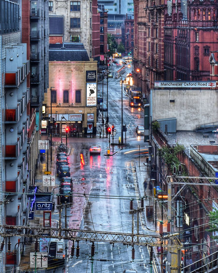 View of city street and buildings during rainy season