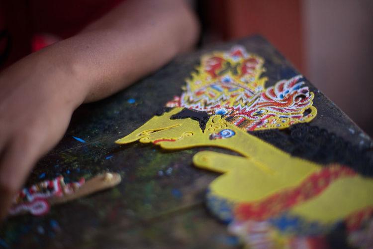 Cropped image of man making handicraft in workshop
