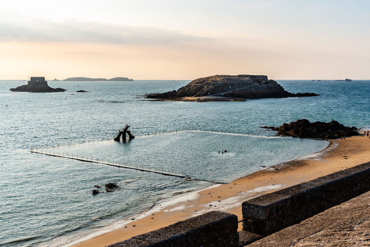 Seascape in Saint-Malo Saint-Malo Brittany Travel France Europe Ocean Sea Water Sky Beauty In Nature Scenics - Nature Horizon Over Water Nature Horizon Outdoors Beach Rock Land Tranquil Scene Tranquility Rock - Object Idyllic Solid Sunset Cloud - Sky Rock Formation