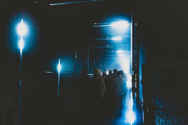 People enjoying at illuminated nightclub