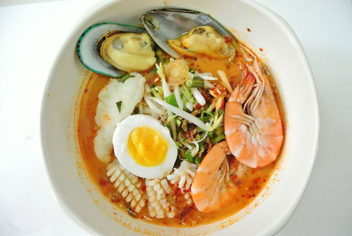 Noodle seafood Tom yum in Thailand. ShareTheMeal Healthy Eating Healthy Eating Egg Food And Drink Egg Yolk Food High Angle View Indoors  No People Freshness Ready-to-eat Close-up Day SEAFOOD🐡 Thailand Mealtime Meal Noodle Indoors  Food And Drink Streetfood