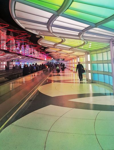 Postcode Postcards Airports Terminal Transportation Transition Color Perspective Linear Walking Indoors  Illuminated Architecture People Real People Men Built Structure Women Lifestyles Adult Interiors