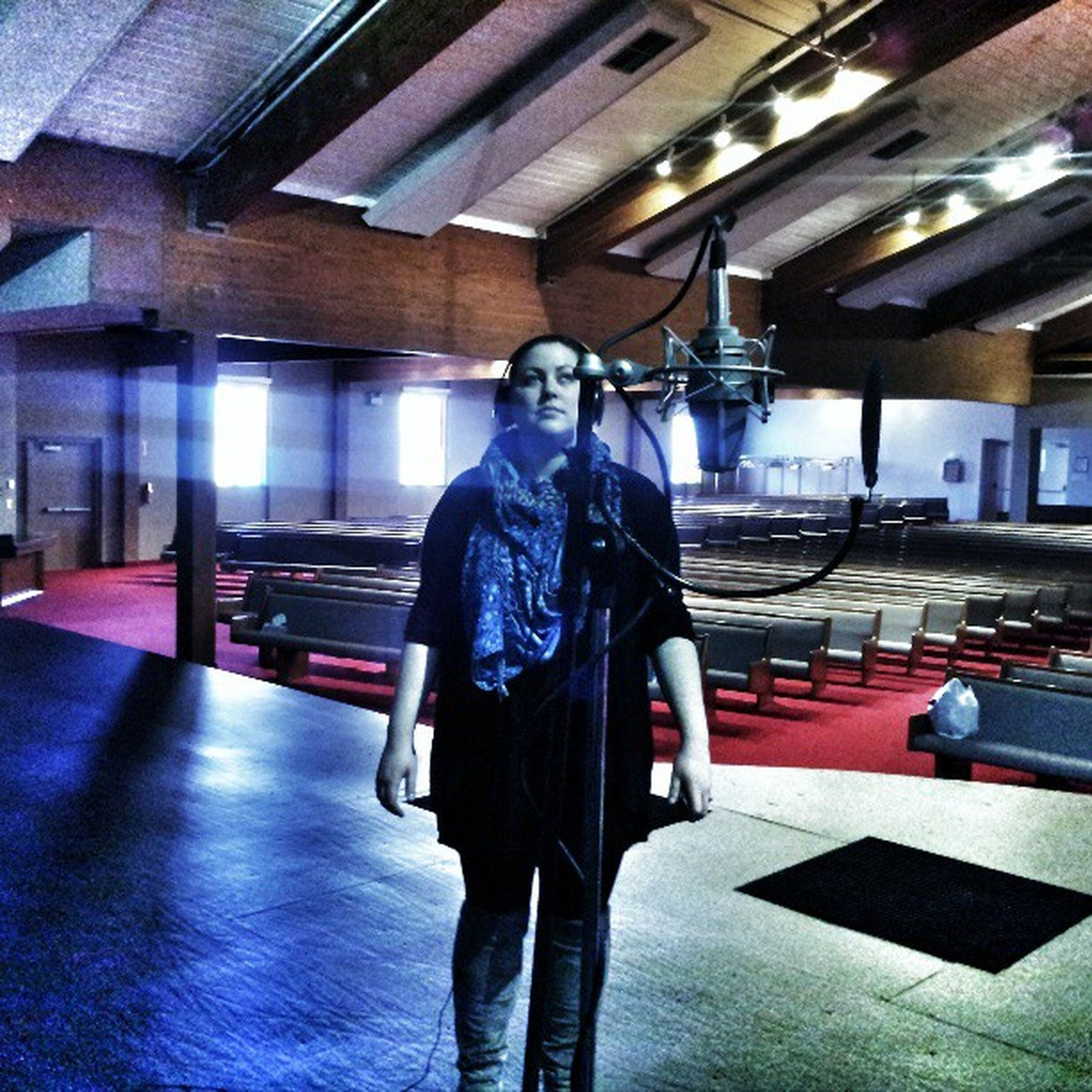 indoors, lifestyles, standing, leisure activity, casual clothing, rear view, three quarter length, full length, illuminated, sitting, built structure, architecture, men, technology, young adult, person, front view, waist up