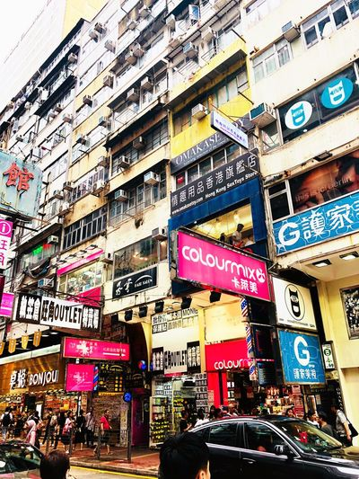 Mongkok Merchants Shop Chinese Text Communication Built Structure No People Architecture Western Script Full Frame Day Building Exterior Multi Colored Backgrounds City Outdoors Wall - Building Feature Graffiti Sign #urbanana: The Urban Playground