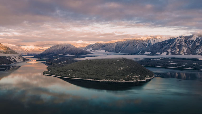 Aerial View Aerial Mountain Range DJI X Eyeem Mountain Sunset Reflection Snow Landscape Water Nature Scenics Lake Ice Beauty In Nature Cloud - Sky Cold Temperature Outdoors No People Winter Beauty Travel Destinations Tranquility Shades Of Winter