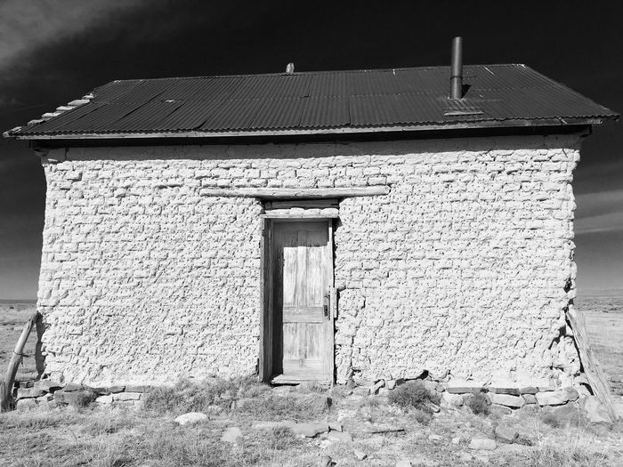 """""""Mystery Ranch No. 27"""" The Bunkhouse #2. New Mexico Photography New Mexico Blackandwhite Photography Black & White Black And White Blackandwhite Bunk House Abandoned Buildings Abandoned Places Abandoned Built Structure Architecture Building Exterior Building Day No People Sunlight Door Old Weathered"""