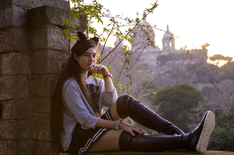 Beautiful Girl Girl Knee-boots Leisure Activity One Person Outdoors People Portrait Real People Relaxation Side View Sitting Spring Stone Wall Teenage Girls Teenager Young Women Women Around The World Women Around The World TCPM