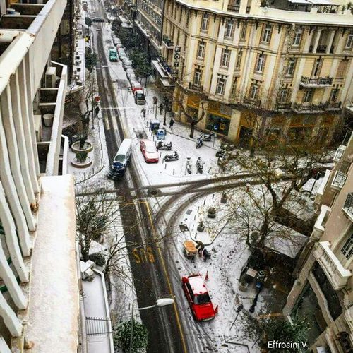 Snow Today.😏 City Old Buildings Architecture Transportation Real People High Angle View Mybalcony Photography Apple 6s Thessaloniki Greece