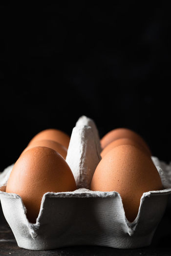 eggs symmetry   food photography Egg Black Background Food Food And Drink Close-up Still Life Fragility Vulnerability  Group Of Objects Raw Food Food Photography Foodphotography Egg Carton Symmetry negative space No People Light And Shadow