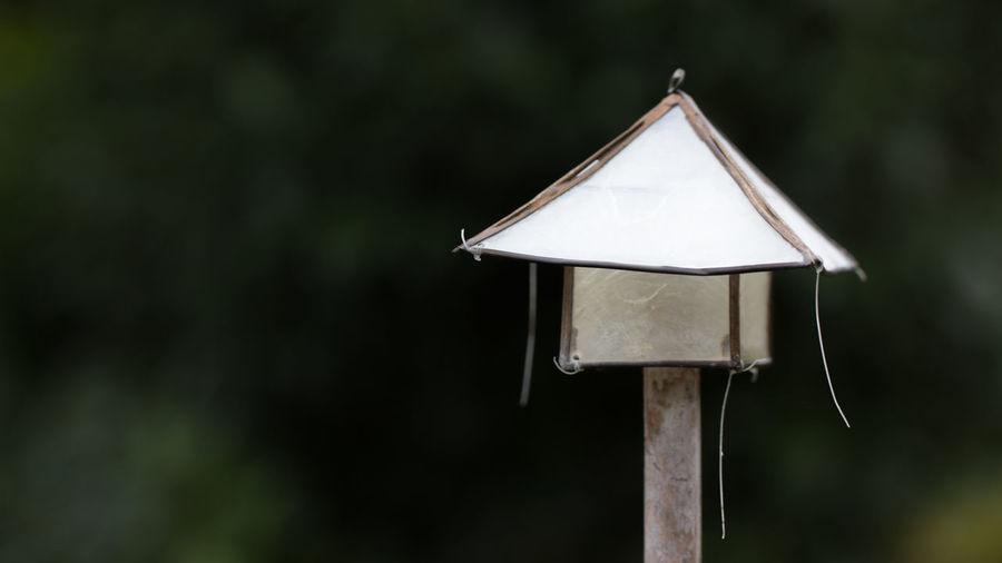 Close-up of birdhouse on land