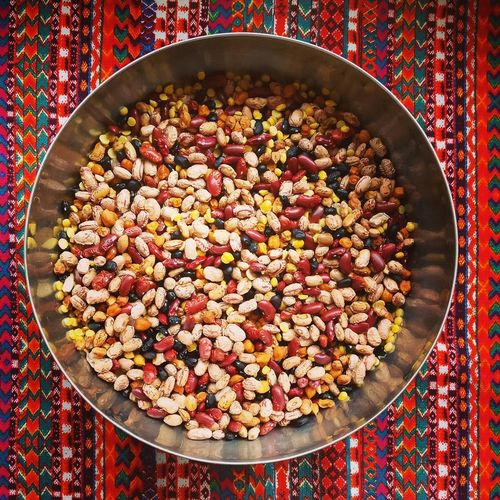 High angle view of multi colored lentils and beans in bowl