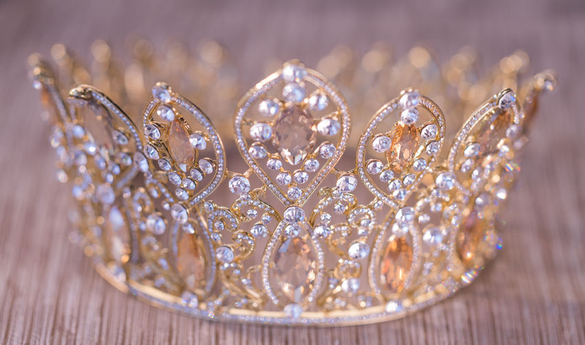 Close-up of crown on table