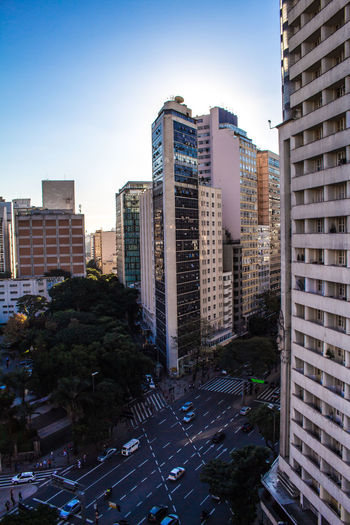 High angle view of street amidst buildings against sky