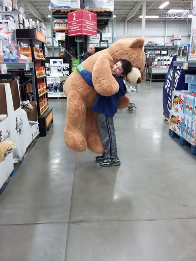 Bear Big Stuffed Bear Big Toys Boy Casual Clothing Christmas Day Full Length Giant Bear Giant Stuffed Animal Person Shopping Stuffed Animals Stuffed Bear Warehouse Club