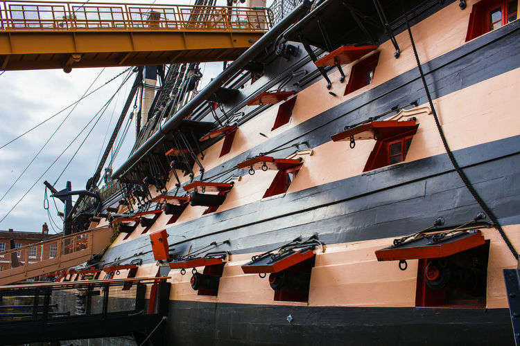 HMS Victory Portsmouth Historic Dockyard Architecture Building Building Exterior Built Structure City Commercial Dock Day Development Industry Low Angle View Machinery Metal Mode Of Transportation Nature Nautical Vessel No People Outdoors Sailboat Ship Sky Transportation