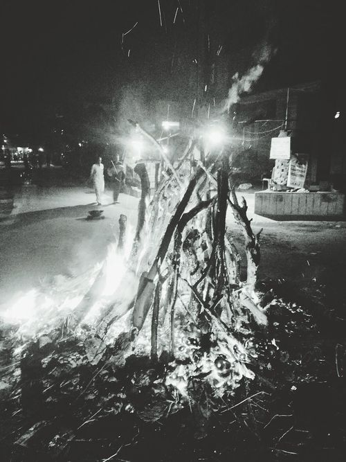 Holika dahan... testament to power of devotion Holikadahan Light And Shadow Fire Illuminated Smoke City Life Logs Firewood Worship Phone Camera Fuelwood Cityscape Light Holiday Holi Blackandwhite Edited