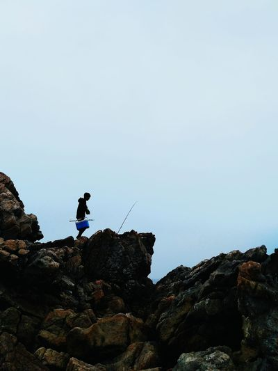 Rock - Object One Man Only Full Length Adventure One Person Only Men Adults Only People Adult Outdoors Sky Exploration Day Leisure Activity Extreme Sports Men Mountain Nature Young Adult One Young Man Only Stone Nature Beauty Beauty In Nature Sea View