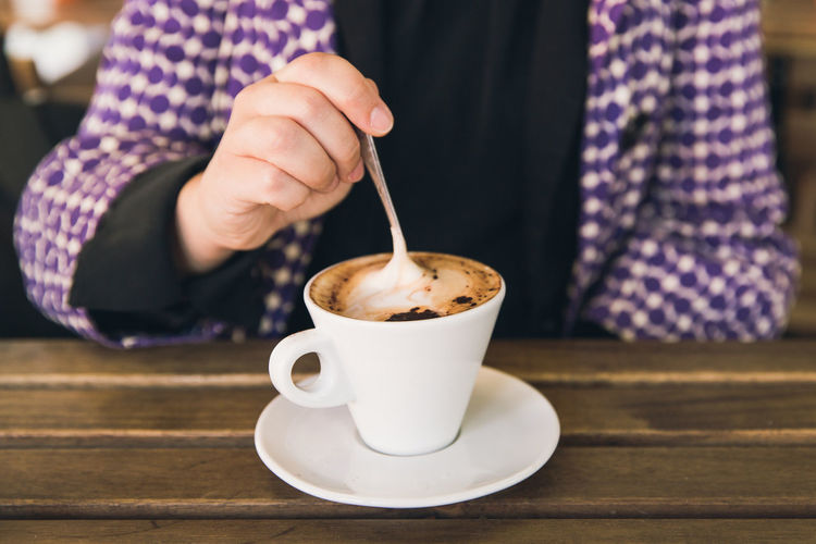A cappuccino is the best way to start a day. Breakfast Breakfast ♥ Morning Cappuccino Coffee - Drink Coffee Cup Cup Drink Focus On Foreground Freshness Frothy Drink Hand Holding Human Body Part Human Hand Real People Refreshment Spoon Table