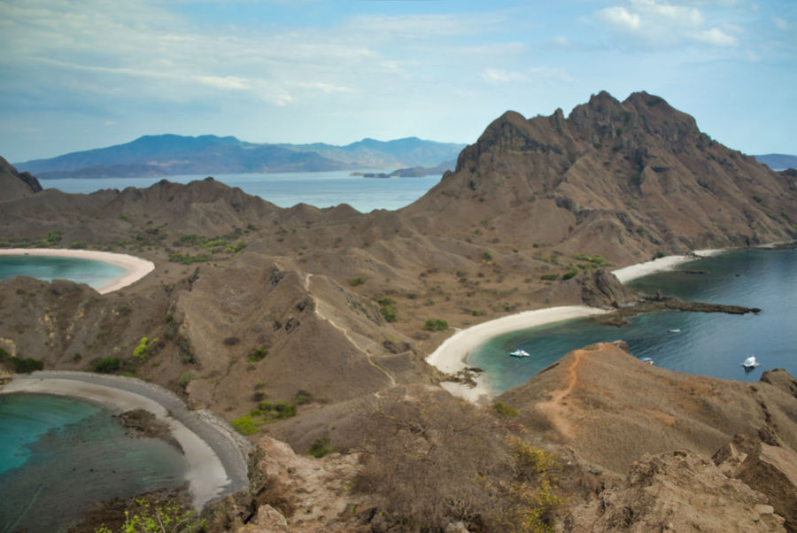 Padar Island near Flores, Indonesia Padar INDONESIA Flores Flores Island Nusa Tenggara Timur Mountain Water Sky Scenics - Nature Mountain Range Beauty In Nature Nature Cloud - Sky Environment Tranquility Tranquil Scene No People Non-urban Scene Landscape Day Rock Land Travel Destinations Outdoors Mountain Peak